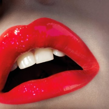 Young woman's mouth with red lipstick, close up --- Image by © Franck Sauvaire/Corbis